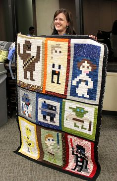 Disclaimer: love it, but never gonna show the guys in my family or I'm gonna get locked in the craft room till I can come out with one!!! Star Wars quilt! So cool!