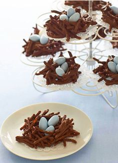 A nest with eggs in it. Chocolate covered pretzel (nest) some kind of cookies for the eggs?!? Easter