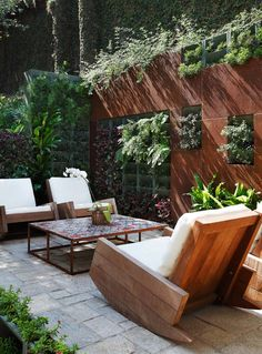 Wooden outdoor rocking chairs, for a small entertaining space outdoors.