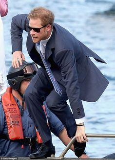 Harry disembarks an RIB speedboatas he arrives into St Georges, Grenada on Monday