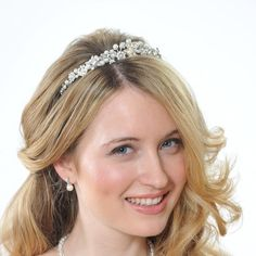 Small but very sparkly, this tiara has a swarovski crystal navette centre feature and swarovski pearls and diamantes