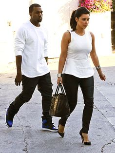 IN LOVE & IN LEATHER  Some couples buy his-and-hers bathrobes, but this twosome splurged on his-and-hers second-skin leather pants, which they styled similarly July 11 in Hollywood, adding white tops and attention-grabbing shoes (studded pumps for Kim, blue-and-black Nikes for Kanye).