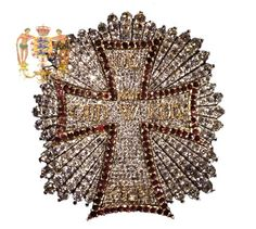 Breast Star of the Order of the Dannebrog made in gold, diamonds and rubies, worn by the Danish Sovereigns.