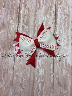 Baseball Hair Bows made from a real Baseball by stitchintutucute
