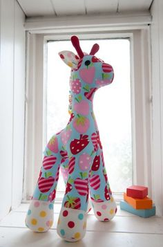 "My first stuffed animal I can remember was a giraffe (I called him ""my raffe"").  He was the traditional polyester plush and in the yellow/brown spotted family (it was the seventies after all).  How amazing is this ""raffe""?  Talk about a cool customer and the colors are vibrant and incredible!!!"