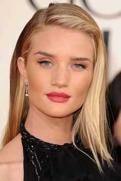 Flawless Skin, Filled in Brow, with a Bright Bronze Lip, and a Black Winged Out Eye, Finished with a Matte Pink Lip.