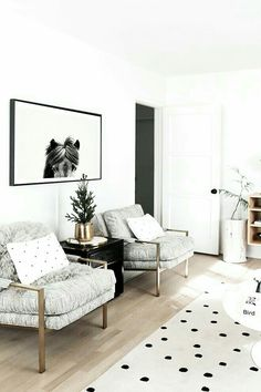 A light and airy neutral living room with modern and organic ...