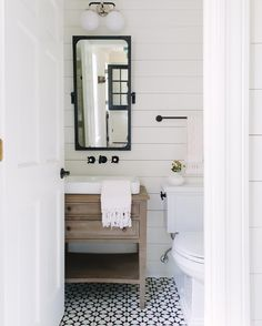 Neutral farmhouse bathroom with black accents. See this Instagram photo by @katemarkerinteriors