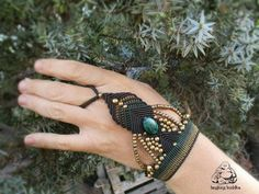 Check out this item in my Etsy shop https://www.etsy.com/listing/292485691/slave-bracelet-chrysocolla-gemstone-ring