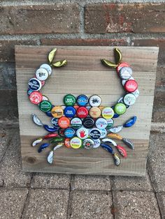 Cute wall hanging perfect for your home, beach, or lake house. Any variation you may desire is available, just reach out and I will do my best to get you the product you want! Bottle Top Art, Bottle Cap Table, Bottle Caps, Beer Bottle, Beer Cap Art, Beer Caps, Liquor Bottle Crafts, Bottle Cap Crafts, Beer Cap Crafts