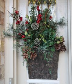 some very pretty winter greenery for a door