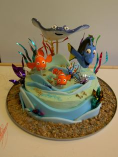 Nemo birthday cake can have many different kinds of designs based on the movie or scenes in the movie. There are a lot of ways to create a Nemo birthday cake Crazy Cakes, Fancy Cakes, Cute Cakes, Fondant Cakes, Cupcake Cakes, Finding Nemo Cake, Finding Dory, Dory Cake, Sea Cakes