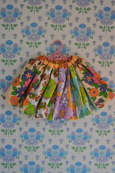 the most adorable little skirt made from vintage fabrics #diy ...I would soo wear this.