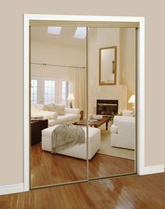 Sliding Mirrored Closet door with gold framing