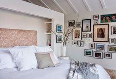 hidden built in bookshelf / gallery wall in guest room / via i suwannee