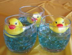 Create these centerpieces for a ducky theme -- they're easy to put together. Just pick a container and add marbles, water and a rubber duck. Guests with kids can take the toys home.