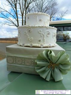 .  Place a simple cake on a box that is elegantly decorated in the wedding colors and blinged up. #Wedding or Bridal Shower #Couture #CakeStand by #CakeItUp