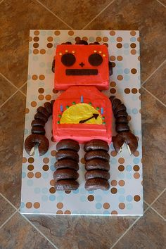 Ideas for Cooper's birthday cake . . . he wants either a dinosaur or a robot - the jury is still out.  This is a cool Robot Cake - maybe not the colors, but I like how the donuts are cut to look like pincher claw hands.