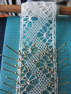 Making lace...can I do this? Someday I will find out. :) bobbin lace by guzzisue, via Flickr