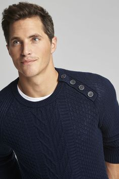 Nautica Raglan Button Crew Sweater. With a substantial feel and a polished look, this sweater features a ribbed texture and the raglan seams are accented with buttons at the left shoulder.