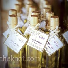 The Knot - In keeping with the olive theme, Sarah and Joel sent guests home with bottles of olive oil (handmade by Joel's sister!). They were tagged with cards featuring the couple's signature logo.