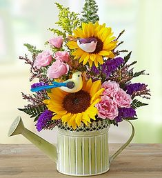 Bring mom the beauty of the country this Mother's Day with our Country Roads floral bouquet in a reusable green watering can! #mothersday