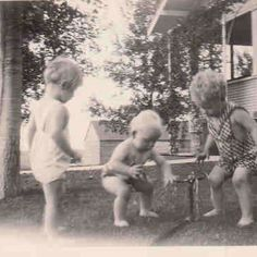 Toddlers playing in sprinkler - the good old days!