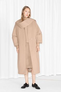 All Oversized Everything: How To Go Big Without Going Home #refinery29  http://www.refinery29.com/fall-oversized-clothing#slide-3  The Oversized OuterwearTo embrace oversized outerwear, you have to get past the idea of wanting your coat to be figure-flattering — that's just not the point when it comes to these boxier buys. Keep your accessories on the more prim side. Here, a sleek black loafer lets you rock the more avant-garde silhouette while feeling more polished than cartoon-ish. ...