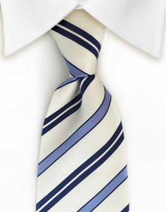 """Product number: ST-7163 Length: 59"""" Width: 3.5"""" Material: 100% Silk Care: Dry Clean Only Label: DUMONTIER This navy, blue and pearly white striped tie adds sophistication to your outfit!"""