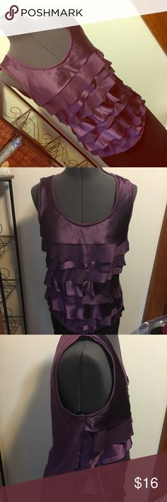 HP 🎉🎈🎈🎈Purple Loft ruffle shirt Pretty purple preloved shirt with silk like ruffles. Great with jeans or for work or suit. Loft size Small. Has some wear under the arms (slight darkening of purple). Hard to tell with lighting. Save on a bundle or add to a bundle with others & I'll send you a private offer. LOFT Tops Camisoles