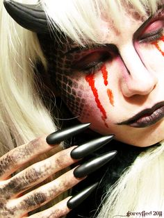 finally i found some sick devil girl make-up :D - buy your crazy contact lenses and accessories at www.youknowit.com #contactlenses #halloween #fancydress
