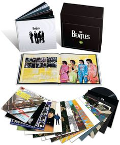 BEATLES VINYL BOX SET - he entire Beatles Catalogue, digitally re-mastered and put on 180 gram vinyl with all the original art work and extras which went along with the original releases.