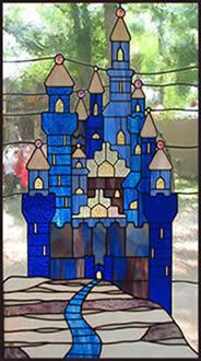 http://www.geminiglass.net/images/artwork/castle_sm.jpg. Could use parts to help make a pattern for the castle and piece together. Good outlines