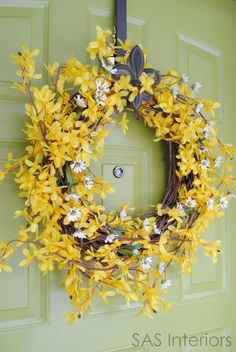 Spring Forsythia Wreath.  Super easy to make.  Takes $5 and $10.  You'll love it for your front door!