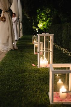 Tall White Lanterns with candles & rose petals -   Image by  Sarah Ferrara Photography - An Italian wedding close to Lake Garda with the bride wearing Atelier Aimee. A classic pink colour scheme.