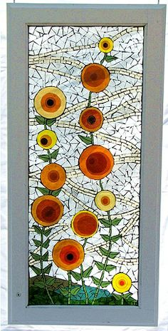Windswept was created by stacking layers of glass to create the image of flowers. This technique not only adds depth, but also color variations normally not found in mosaics. Theresa Hollmeyer
