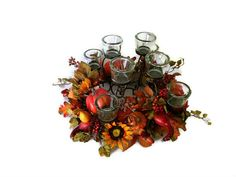 Enjoy your Thanksgiving meal by candlelight with this festive centerpiece by Perpetualposy on Etsy.