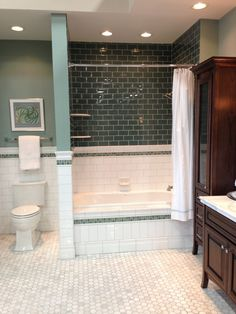Blue glass tile, subway tile, and honeycomb floor