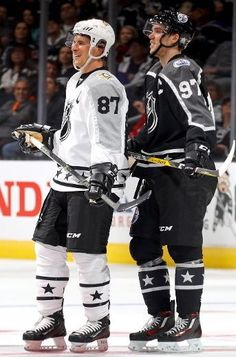 Sidney Crosby #87 of the Pittsburgh Penguins and Connor McDavid #97 of the Edmonton Oilers react during the 2017 Honda NHL All-Star Tournament Final between the Pacific Division All-Stars and the Metropolitan Division All-Stars at Staples Center on January 29, 2017 in Los Angeles, California.