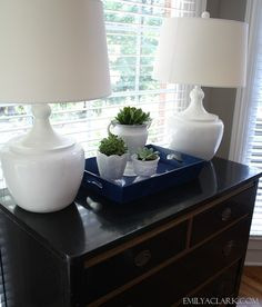 Emily A. Clark - avoid clutter by styling the tops of cabinets, etc. That way, no one is tempted to throw clutter on top.