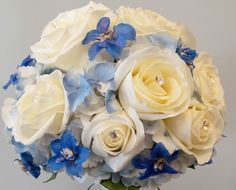 white roses and blue delphinium.