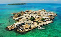 Two hours off the coast of Cartagena, Colombia, and you'll hit the island of Santa Cruz del Islote in the Caribbean Sea, nestled in the archipelago of . Ocean City, Manhattan, Best Places To Travel, Places To See, Resorts, Magic Places, Santa Cruz Island, Explorer, Travel News