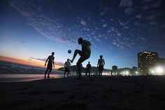 Rio de Janeiro, Brazil: Revellers play football at sunset during carnival celebrations on Ipanema beach     Photograph: Mario Tama/Getty Images