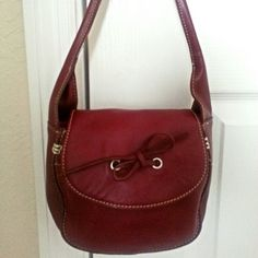 "Adorable Isaac Mizrahi Deep Red Leather Handbag Lovely Isaac Mizrahi buttery soft deep red leather handbag. Perfect small sized for a night out when you don't want to carry regular size bag with you. Absolutely too cute! Bag features all soft leather outside, beautiful stitch details, leather tie bow on flap pocket, snap closure, 10"" strap, bright pink satin lining, a pocket compartment inside & a zipper compartment also! *BRAND NEW WITHOUT TAG* Isaac Mizrahi Bags"