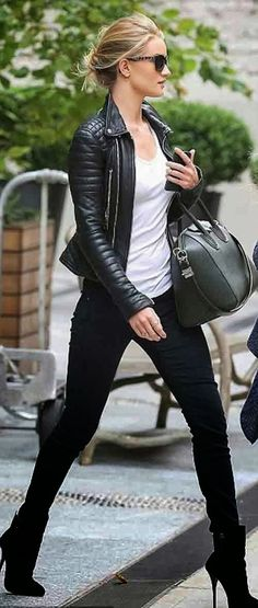 Hot in black. ladies black boots, black legging with black stunner leather jacket, black sunglasses, and a great bag.