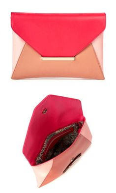 Colorblocked envelope clutch with a snap front closure. Ideal for that day-to-night transition.