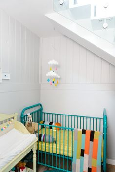 Bedroom nook under the stairs with Incy Interior cot