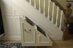 Under Stairs Storage Ideas-by front door to encourage guests to remove shoes - decor table behind opening
