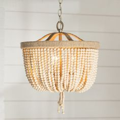 Blending urbane design with rustic touches, this beaded 3-light chandelier adds a dash of chic style to your home. Let it illuminate your reading nook with sleek steel wall sconces, or cast a warm glow in the foyer.