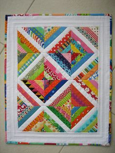 Use striped fabric with the white strip in the middle. Or quarter triangle squares on point with white sashing.